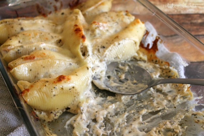Cheesy Chicken Stuffed Shells with Pesto Sauce are sure to become a family favorite recipe!
