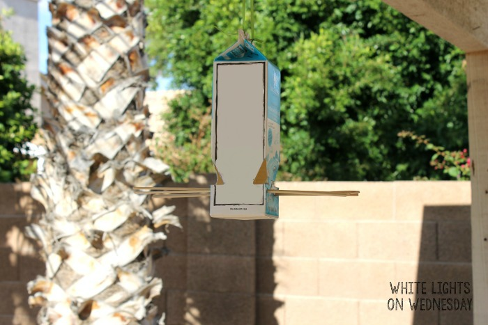 Easy Milk Carton Bird Feeder | White Lights on Wednesday #RaisingGoodApples #ad