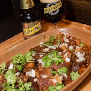 Rick Bayless' Slow Cooker Lamb Barbacoa with Negra Modelo is packed with traditional Mexican flavors and is surprisingly easy to make!